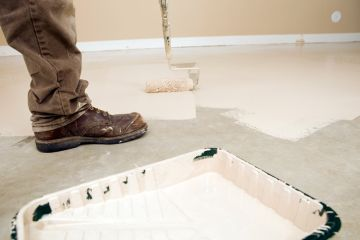 Painter painting garage floor in Hillsboro