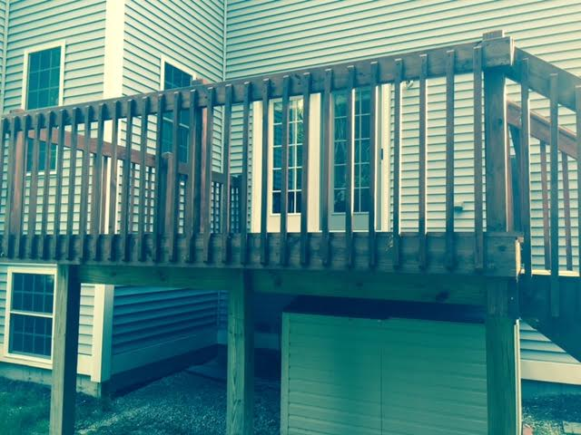 Deck staining in Manchester, NH by MF Paint Management, LLC.